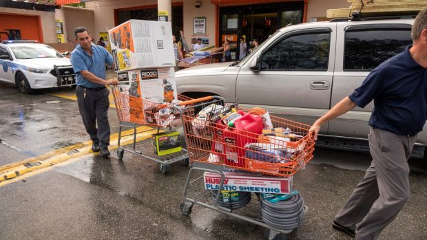Miami residents buying supplies at a hardware store to be prepared for Hurricane Irma. Photograph: Cristobal Herrera/EPA