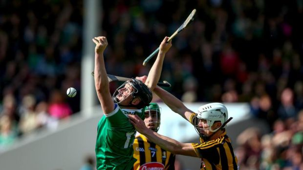 Kilkenny's Michael Cody and Peter Casey of Limerick battle for possession. Photograph: Cathal Noonan/Inpho