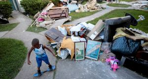 Darius Smith, 9, is surrounded by water damaged property as he plays at Crofton Place Apartments in the aftermath of Hurricane Harvey in Houston, Texas. Photograph: Chris Aluka Berry/Reuters