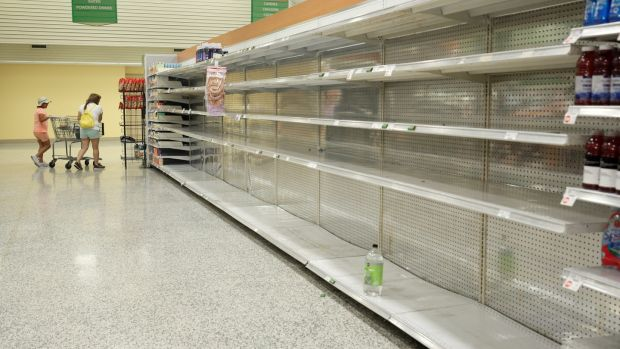 A lone bottle of water sits on empty supermarket shelves as last-minute shoppers made final preparations ahead of the arrival of Hurricane Irma making landfall in Kissimmee, Florida on September 9, 2017. Photograph: Reuters/Gregg Newton