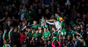 Limerick players celebrate with the cup after  beating Kilkenny in the All-Ireland under-21 hurling final  at Semple Stadium. Photograph: Cathal Noonan/Inpho
