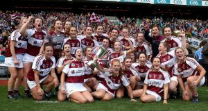 The Westmeath team celebrate winning Liberty Insurance All-Ireland Premier Junior Camogie Championship Final against Dublin at  Croke Park. Photograph: Bryan Keane/Inpho
