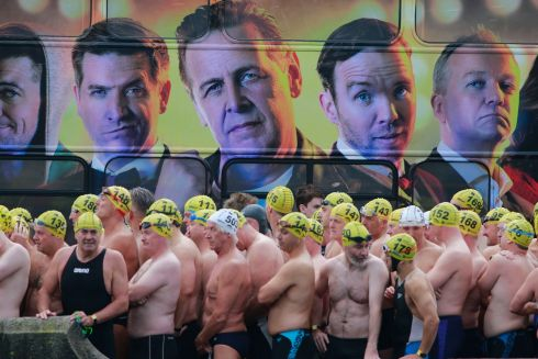 Male competitors overseen by an advertising display at the start on Dublin's Victoria Quay for the start of this years Liffey swim on Saturday. The 98th Dublin City Liffey Swim was organised by Leinster Open Sea and supported by Jones Engineering, Dublin City Council and Swim Ireland.  Photograph Nick Bradshaw / The Irish Times
