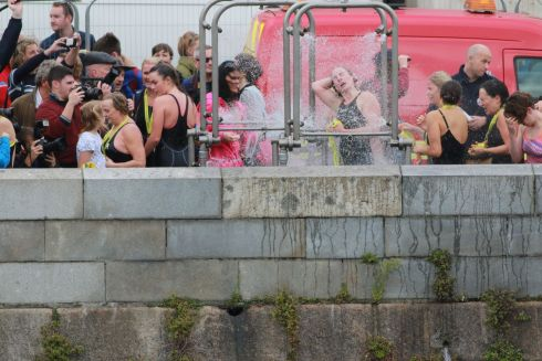 Power Shower - female competitors showering after emerging from the Liffey at the end of this year's Dublin City Liffey Swim. Photograph Nick Bradshaw / The Irish Times