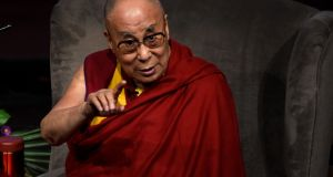 Tibetan spiritual leader the Dalai Lama, Patron of Children in Crossfire, gestures at an event called 'Compassion in Action' in Derry. Photograph: Clodagh Kilcoyne/Reuters