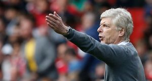 Arsene Wenger: Little outward support for the manager in Arsenal's 3-0 win over Bournemouth.   Photograph:  Ian Kington/AFP/Getty Images