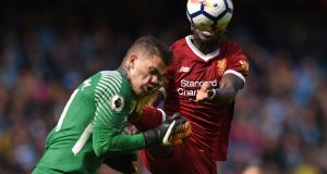 Liverpool midfielder Sadio Mane  challenges Manchester City  goalkeeper Ederson, which led to his sending off. Photograph:  Oli Scarff/AFP/Getty Images