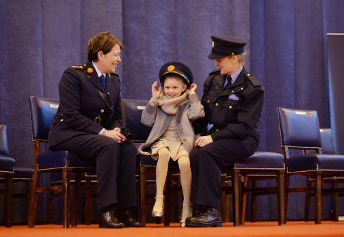 'ROLE MODEL': O'Sullivan lends her cap to Eva Counihan (8) whose mother Leonora Power was one of 62 new members of the Garda Reserve graduating at in November 2014. Photograph: Alan Betson/The Irish Times