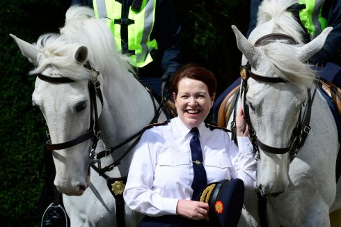 RIDING INTO THE SUNSET: O'Sullivan with Garda horses during her visit to Farmleigh where students gathered to show the commissioner their work on policing. Photograph: Cyril Byrne/The Irish Times