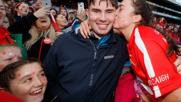 Cork's Amy O'Connor kisses her partner Daniel Morrissey after the victory over Kilkenny. Photograph: James Crombie/Inpho