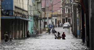 A flooded street in Havana, Cuba, on Sunday, after the aftermath of  Hurricane Irma  forced the evacuation of thousands of people. Photograph: Ernesto Mastrascusa/EPA