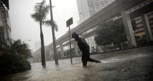 A local resident walks across a flooded street in downtown Miami as Hurricane Irma arrives at south Florida. Photograph:  Reuters/Carlos Barria