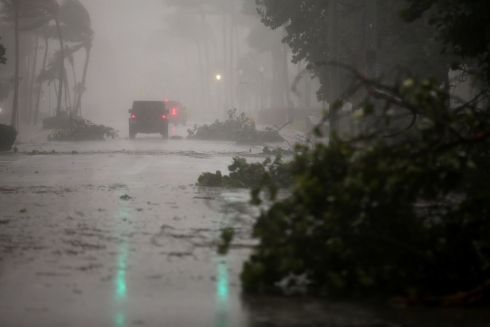 Vehicles drive along Ocean Drive in South Beach as Hurricane Irma arrives at south Florida. Photograph: Carlos Barria/Reuters