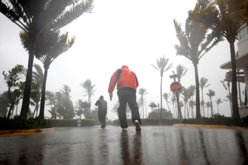 People walk along a street in South Beach as Hurricane Irma arrives at south Florida, in Miami Beach, Florida. Photograph: Carlos Barria/Reuters