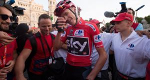 Chris Froomer celebrates after winning the Vuelta a España. Photograph: Denis Doyle/Getty