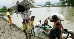 Rohingya refugees carry their belongings as they arrive in  Bangladesh. Photograph: Abir Abdullah/EPA