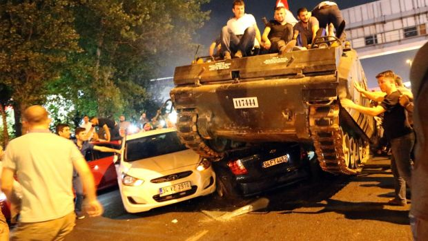 People on a tank run in Istanbul, on July 16th, 2016 – the night of a failed coup attempt in Turkey. Photograph: Tolga Bozoglu/EPA