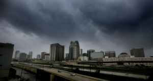 Storms clouds  over the skyline of downtown Orlando as Hurricane Irma makes its way up the Florida peninsula. Photograph: Joe Burbank/Orlando Sentinel/TNS via Getty Images