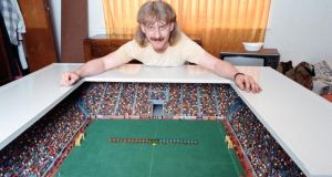 Carl Pownall shows off his impressive Subbuteo set and stadium. Photograph: Getty Images