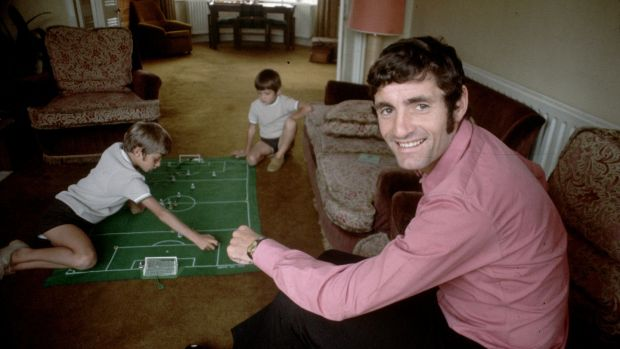 Arsenal footballer Frank McLintock at home watching his children playing the football game Subbuteo. Photograph: Express/Express/Getty Images