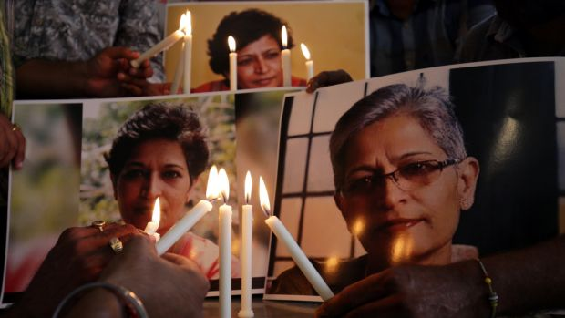 Members of the National Human Rights and Crime Control Organisation place candles near photographs of Indian journalist Gauri Lankesh during a vigil in Amritsar, India. Photograph: Raminder Pal Singh/EPA