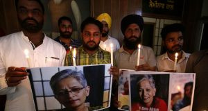 Members of the National Human Rights and Crime Control Organisation hold candles along with photographs of Indian journalist Gauri Lankesh during a  vigil in Amritsar, India. Photograph: Raminder Pal Singh/EPA