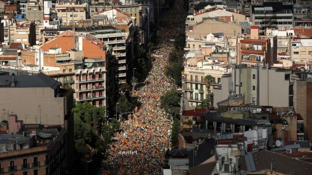 Thousands of people gather for a rally on Catalonia's national day, in Barcelona, Spain. Photograph: Albert Gea/Reuters