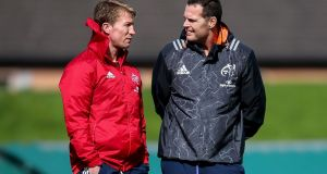 Munster scrum coach Jerry Flannery with head coach Rassie Erasmus during training at UL. Photograph: Bryan Keane/Inpho