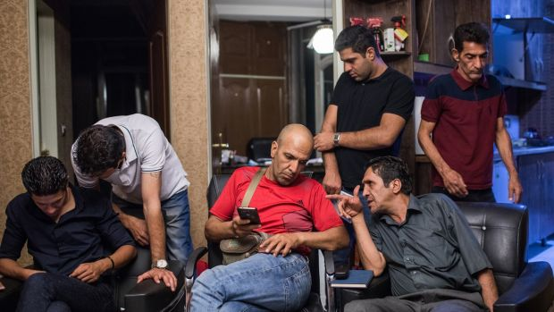 Members talk after an Alcoholics Anonymous association meeting in Tehran on August 27th. Photograph: Arash Khamooshi/The New York Times