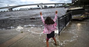 A girl dances beside high water levels after Hurricane Irma in Jacksonville, Florida U.S. September 11, 2017. REUTERS/Mark Makela