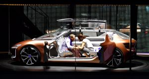 A couple sits inside the Renault prototype Symbioz