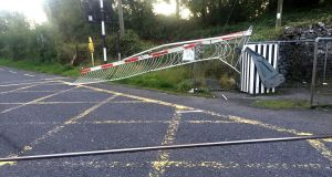 Gardaí in Galway are searching for the driver of a white van that smashed through the closed gates of a level crossing. Photograph: Press 22