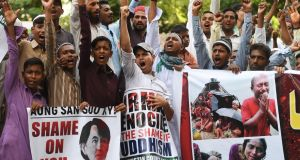 "Protesters took to the streets of Pakistan's major cities  to condemn a crackdown on Rohingya Muslims in Myanmar, with many carrying placards stating ""Shame on Aung San Suu Kyi"".  Photograph: Asif Hassan/AFP/Getty Images"