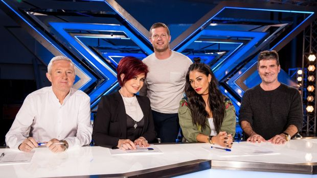 The X Factor: Dermot O'Leary with judges Louis Walsh, Sharon Osbourne, Nichole Scherzinger and Simon Cowell. Photograph: Tom Dymond/Thames/Syco