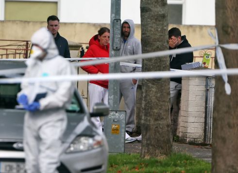 SHOT DEAD: Relatives and friends of Darragh Nugent, who was shot dead at Wheatfields Avenue, Clondalkin, Dublin, gather at the scene the following morning. Photograph: Colin Keegan/Collins Dublin