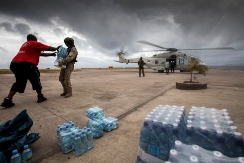 IRMA'S IRE: Dutch soldiers unload bottles of drinking water at Sint Maarten International Airport in the Dutch part of Saint Martin island, in the Caribbean, in the wake of Hurricane Irma. Photograph: Netherlands Ministry of Defence/Reuters