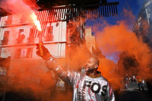 LABOUR LAW REFORM PROTEST: A worker of ArcelorMittal holds a flare during a protest called by several French unions against labour law reform in Marseille, southern France. Photograph: Anne-Christine Poujoulat/AFP/Getty Images