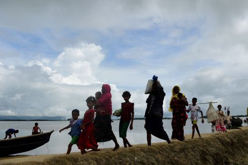 MYANMAR EXODUS: Rohingya Muslim refugees arrive in the Bangladeshi town of Teknaf from Myanmar after crossing the Naf river, on September 12th, 2017. Some 370,000  Rohingya have fled Myanmar and entered Bangladesh since an upsurge in violence late last month, the United Nations said. Photograph: Munir Uz Zaman/AFP/Getty Images