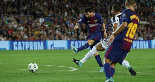 d2ac4173467 Barcelona s Lionel Messi scores against Juventus in the Champions League  match at the Nou Camp.