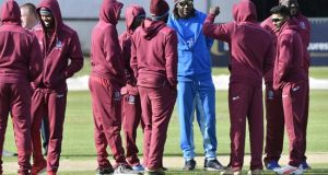 Chris Gayle with his West Indies teammates ahead of the washout in Belfast. Photograph: Rowland White/Inpho