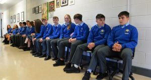 Eight sets of twins: Michelle and Noelle Curtin, Shona and Caoimhe Hickey, Micah and Ryan O'Connell, David and Jack O'Connor, Christopher and Chloe Lane, Maeve and Orla Quirke, and Holly and Luke Scannell wait for their Junior Cert results at Coláiste Íde agus Iosef. Photograph: Domnick Walsh/Eye Focus