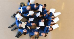 Eight sets of twins: Michelle and Noelle Curtin, Shona and Caoimhe Hickey, Micah and Ryan O'Connell, David and Jack O'Connor, Christopher and Chloe Lane, Maeve and Orla Quirke, and Holly and Luke Scannell with their Junior Cert results at Coláiste Íde agus Iosef. Photograph: Domnick Walsh/Eye Focus