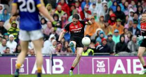 Mayo's Paddy Durcan kicking  an  equalising point against Kerry in Croke Park to force a semi-final replay. Photograph:  Ryan Byrne/Inpho