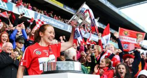 Cork's Rena Buckley lifting the  O'Duffy Cup. There are certain things in life like taxes and death, but you can add  Buckley winning an All-Ireland medal to that list.  Photograph: Gary Carr/Inpho