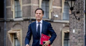 Dutch prime minister Mark Rutte:  managed to convince the other three parties the Liberals are in coalition with    to commit to a theoretical, unspecified, pay deal for primary school teachers. Photograph:   Robin Utrecht/EPA