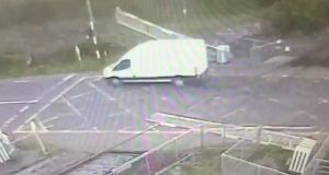 A still from a CCTV video showing a van smashing through a level crossing in Co Galway. Photograph: Iarnrod Eireann