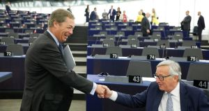 European Commission president Jean-Claude Juncker (right) shakes hands with former UK Independence Party leader Nigel Farage, before addressing the members of the European Parliament in Strasbourg. Photograph: Jean-Francois Badias/AP Photo