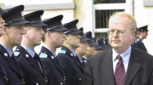 Former minister for justice Michael McDowell inspects a guard of honour at a Garda graduation ceremony in Templemore. File photograph: Brenda Fitzsimons