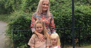 Caroline Sweeney with her daughters, Jamie and Zara