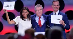 International Olympic Committee (IOC) president Thomas Bach (centre) poses for pictures with Paris mayor Anne Hidalgo  and Los Angeles mayor Eric Garcetti at the announcement of the host  cities for 2024 and 2028. Photograph: Fabrice Coffrini/AFP/Getty Images